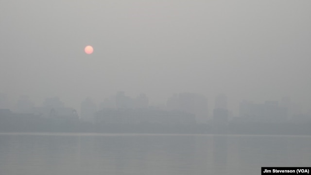 Smog can be seen over the Hangzhou skyline.