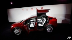 FILE - The Tesla Model X car is introduced at the company's headquarters in Fremont, California, Sept. 29, 2015.