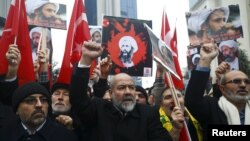 Shi'ite protesters carry posters of Sheikh Nimr al-Nimr during a demonstration in front of Saudi Arabia's Consulate in Istanbul, Turkey, Jan. 3, 2016.
