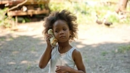 "Quvenzhane Wallis as ""Hushpuppy"" on the set of Beasts of The Southern Wild (Photo: Fox Searchlight / Jess Pinkham)"