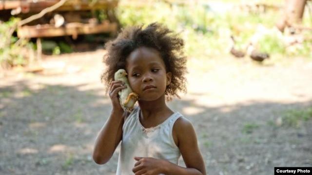 "Quvenzhane Wallis as ""Hushpuppy"" on the set of Beasts of The Southern Wild (Photo: Fox Searchlight / Jess Pinkham)"