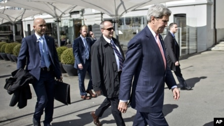 US Secretary of State, John Kerry, right, walks back to the talks venue after a lunch break during the Iran nuclear program talks in Lausanne, Switzerland, Monday, March 30, 2015.