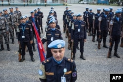FILE - The Nepalese garrison stands at attention during the official closing ceremony of the United Nations Stabilization Mission in Haiti (MINUSTAH) in Tabarre Haiti on Oct. 5, 2017.