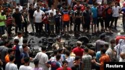 Место взрыва бомбы в автомобиле в Садр-Сити. Ирак, 11 мая 2016.
