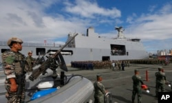Philippine Marines, who took part in the battle against Muslim militants in the besieged city of Marawi in southern Philippines, are given a heroes welcome upon disembarking from the Philippine Navy amphibious ship BRP Tarlac, Oct. 30, 2017.
