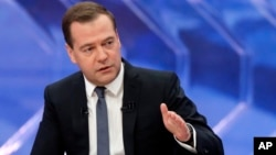 Russia's Prime Minister Dmitry Medvedev speaks during a nationwide live TV show at Moscow's Ostankino TV center, Dec. 10, 2014.