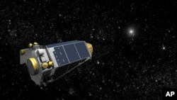 An artist's concept provided by NASA shows the Keplar Spacecraft moving through space.