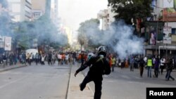 Riot policemen fire teargas a canister to disperse supporters of Kenyan opposition