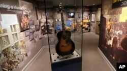 U.S. musician Jimi Hendrix's Epiphone acoustic guitar is displayed in an exhibition space at the central London flat he used to live in at 23 Brook Street, London, Feb. 8, 2016. The guitar will be sold in auction Thursday, Dec. 15, 2016.