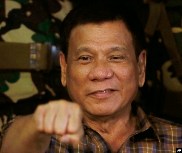 Philippine President Rodrigo Duterte, sen in this Aug. 25, 2016, gestures with a fist bump during his visit to the Philippine Army's Camp Mateo Capinpin at Tanay township, Rizal province east of Manila, Philippines. The Philippine president has apologized Philippine President Rodrigo Duterte gestures during his visit to the Philippine Army's Camp Mateo Capinpin at Tanay township, Rizal province east of Manila, Philippines.