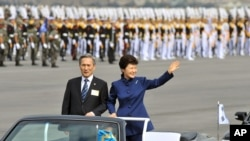 FILE - South Korean President Park Geun-hye waves as she inspects troops with Defense Minister Kim Kwan-jin during a ceremony marking the 65th anniversary of the founding of South Korea's Armed Forces, Seongnam, Oct. 1, 2013.