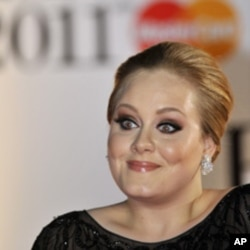 Singer Adele arrives at the Brit Awards in London