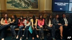Invited students from Yuma and Pueblo, Colorado, listen to a Colorado Legislature debate on a bill which would grant in-state tuition to undocumented students, inside the State Capitol, in Denver, March 5, 2013.
