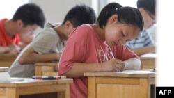 Etudiants passant un examen en Chine, 7 juillet 2020. (Photo AFP)