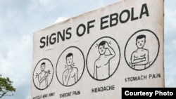 FILE - Sign displaying the symptoms of Ebola. (Credit: AGI)