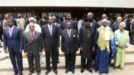 Heads of state and members of the Economic Community Of West African States (ECOWAS) pose for a photograph after attending the 39th ECOWAS Summit in Abuja, March 23, 2011.