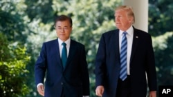 FILE - U.S. President Donald Trump walks with South Korean President Moon Jae-in to make statements in the Rose Garden at the White House in Washington, June 30, 2017.