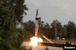 FILE - A surface-to-surface Agni V missile is launched from the Wheeler Island off the eastern Indian state of Odisha, April 19, 2012.