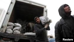 Moskva bozorlaridagi migrant ishchilar