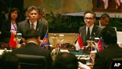ASEAN Secretary General Surin Pitsuwan, left, and Indonesia's Foreign Minister Marty Natalegawa attend the ASEAN Ministerial meeting in Nusa Dua, Bali, Indonesia, July 19, 2011