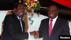 Presidente Robert Mugabe e o primeiro-ministro Morgan Tsvaingirai em Harare, Maio 2013