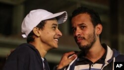 Egyptian activist Mahmoud Mohammed Ahmed, left, smiles next to his brother, Tarek, after his release from a police station in Cairo, Egypt, March 24, 2016.