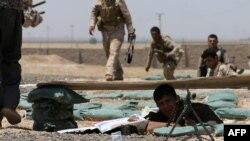6月29日庫爾德軍隊與伊拉克和黎凡特伊斯蘭國極端分子作戰。