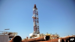 Drilling tubing is piled next to the drilling site number 102 in the Unity oil field, South Sudan (2010 file photo).