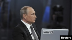 Russian President Vladimir Putin takes part in a live broadcast nationwide call-in in Moscow, April 16, 2015.