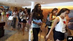 Miss World pageant contestants leave Bali International Convention Center after a rehearsal in Nusa Dua, Bali, Indonesia on September 16, 2013.