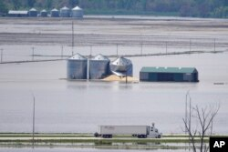 FILE - Grain bins stand in floodwaters from the Missouri River, in Hamburg, Iowa, May 10, 2019.