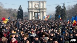 People attend the rally in front of the Parliament building in Chisinau on January 21, 2016.