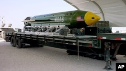 This undated photo provided by Eglin Air Force Base shows a GBU-43B, or massive ordnance air blast weapon, the U.S. military's largest non-nuclear bomb, which contains 11 tons of explosives. The Pentagon said U.S. forces in Afghanistan dropped a GBU-43B on an Islamic State target in Afghanistan, April 13, 2017, in what a Pentagon spokesman said was the first-ever combat use of the bomb.