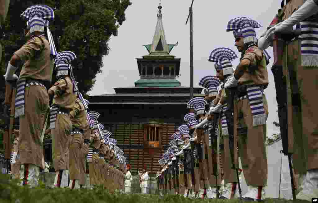 Jammu and Kashmir policemen present a guard of honor at the Martyr's graveyard in Srinagar, Indian-controlled Kashmir. July 13 is observed as Martyrs' Day in memory of the day when the region's Hindu king ordered more than 20 Kashmiri Muslims executed in a bid to put down an uprising in 1931.