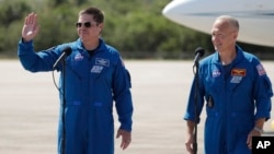 NASA astronauts Robert Behnken , left, and Doug Hurley take part in a news conference after they arrived at the Kennedy Space Center in Cape Canaveral, Fla., Wednesday, May 20, 2020. (AP Photo/John Raoux)
