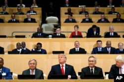 "President Donald Trump participates in a photo before the beginning of the ""Reforming the United Nations: Management, Security, and Development"" meeting during the United Nations General Assembly at U.N. headquarters, Sept. 18, 2017."