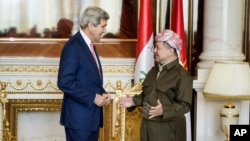 U.S. Secretary of State John Kerry, left, speaks with Kurdish regional President Massoud Barzani, ahead of a meeting in Irbil, Iraq, Tuesday, June 24, 2014.