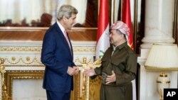 U.S. Secretary of State John Kerry, left, speaks with Kurdish regional President Massoud Barzani, ahead of a meeting in Irbil, Iraq, Tuesday, June 24, 2014.