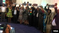 President Mnangagwa and other political leaders in Zimbabwe holding hands in Harare on Friday.
