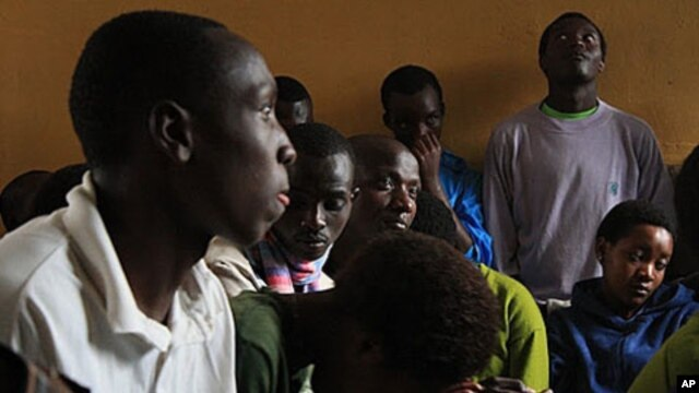 Teenage Orphans listen as officials explain that the Noel Orphanage will be downsized, and they will be relocated.
