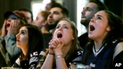 Kathleen Doherty, center, of Woburn, Mass., reacts with other fans at a Boston bar while watching the New England Patriots' final drive during the first half of the NFL Super Bowl 52 football game between the Patriots and the Philadelphia Eagles in Minneapolis, Sunday, Feb. 4, 2018.