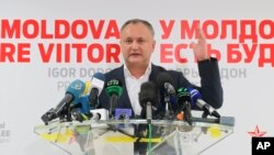 Socialist Party presidential candidate Igor Dodon speaks to the media after voting ended in the presidential elections, in Chisinau, Moldova, Nov. 13, 2016. Dodon, who campaigned on promises to restore closer ties with Russia, was running against pro-Europe candidate Maia Sandu.