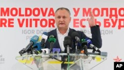 Moldovan presidential candidate Igor Dodon speaks to the media after voting ended in the presidential elections, in Chisinau, Moldova, Nov. 13, 2016. Dodon has been eager to scrap an EU association agreement in favor of a trade deal with Moscow.