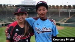 Emma March, from Canada, and Mo'ne Davis, from the U.S., are the two girls playing in the 2014 Little League World Series. (Photo from LLB, Inc.)