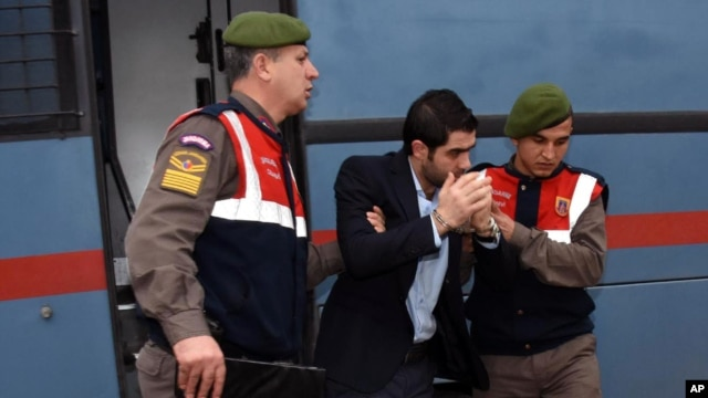 Prison guards escort Asem Alfrhad before his trial in Aegean resort of Bodrum, Turkey, Feb. 11, 2016. Two alleged smugglers of migrants are on trial accused of causing the death of 3-year-old Syrian migrant boy Aylan Kurdi and four other people.