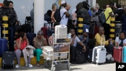 Stranded passengers waiting for their flights out of JKIA airport in Nairobi, Kenya, March 6, 2019.