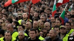 FILE - Hundreds of Bulgarian policemen, prison guards and firemen rally in front of the Parliament building in Sofia, Nov 8, 2015, protesting planned benefit cuts. Sinking wages and living standards have been a major driver of anti-government sentiment in the former Soviet bloc country.