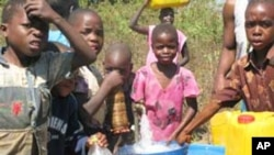 Children in Mwanza at one of the water taps