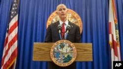 Florida Governor Rick Scott lays out his school safety proposal during a press conference at the Florida Capitol, in Tallahassee, Florida, Feb. 23, 2018.