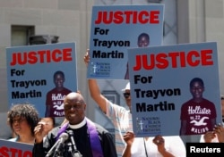 FILE - Rev. Anthony Evans, president of the National Black Church Initiative, speaks to the media during a demonstration asking for justice for Trayvon Martin, outside the Department of Justice in Washington, July 15, 2013.